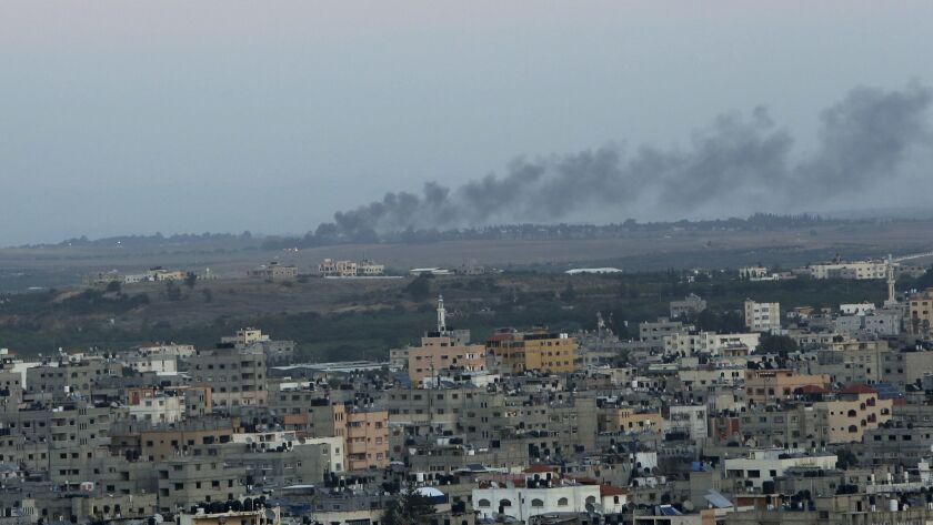 Smoke rises from a mortar attack by Gaza militants on Israel, in Gaza City, Monday, Nov. 12, 2018. P