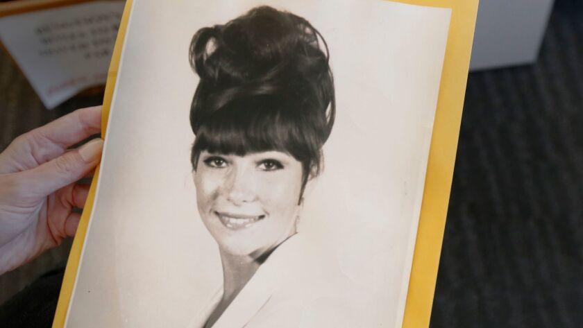 A photo of Wendy Jo Halison held by her sister, Linda Kort Trocino.