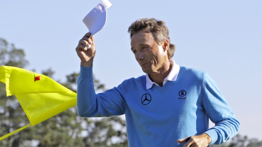 Bernhard Lange tips his cap to the crowd after putting out at No. 18 during the third round of the Masters on Saturday.