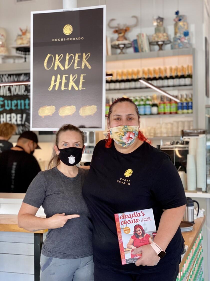 Maeve Rochford (left) and Claudia Sandoval at Sugar & Scribe, where Sandoval's Cochi Dorado goods will be sold through June.
