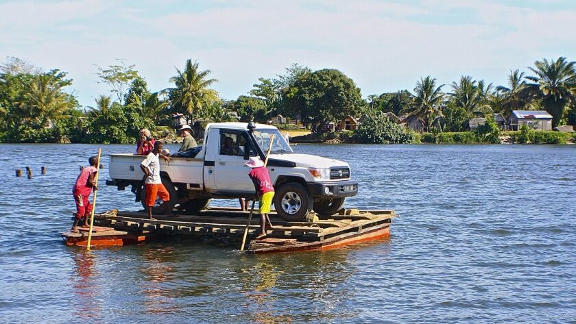 A road trip of any length in Madagascar requires one or several river crossings by ferry.  The truck is driven onto a crude pontoon vessel and propelled by long bamboo poles from one side to the other.  The ferrymen assured that they hardly ever lose a vehicle.