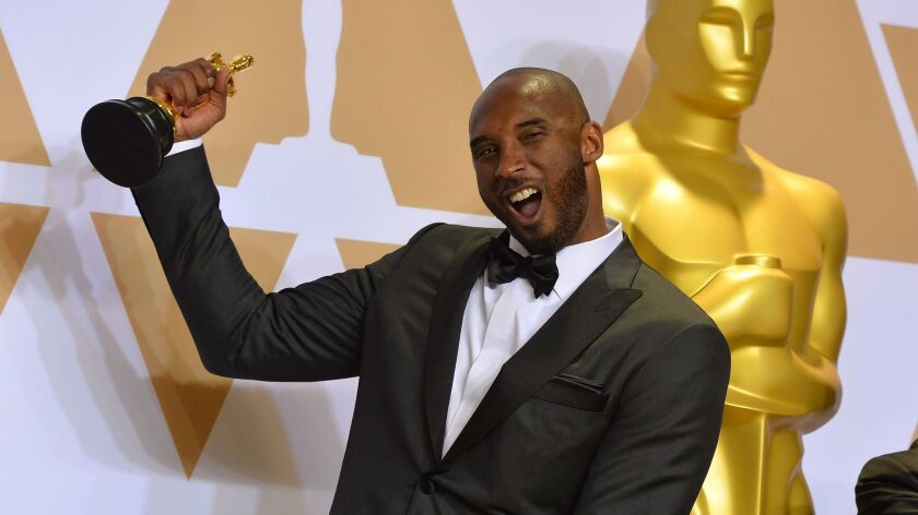 "Kobe Bryant, who won an Oscar for his animated short film, ""Dear Basketball,"" poses backstage at the Academy Awards in Hollywood on March 4."