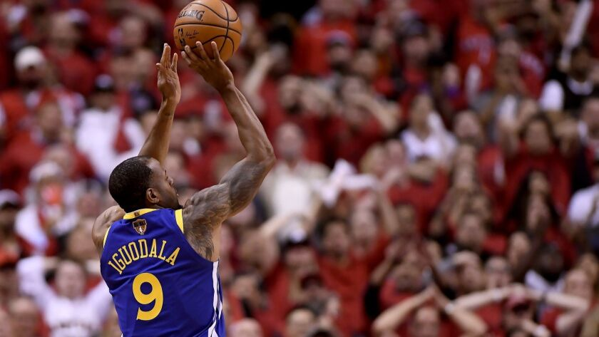 Golden State Warriors' Andre Iguodala (9) shoots against the Toronto Raptors during the second half of Game 2.