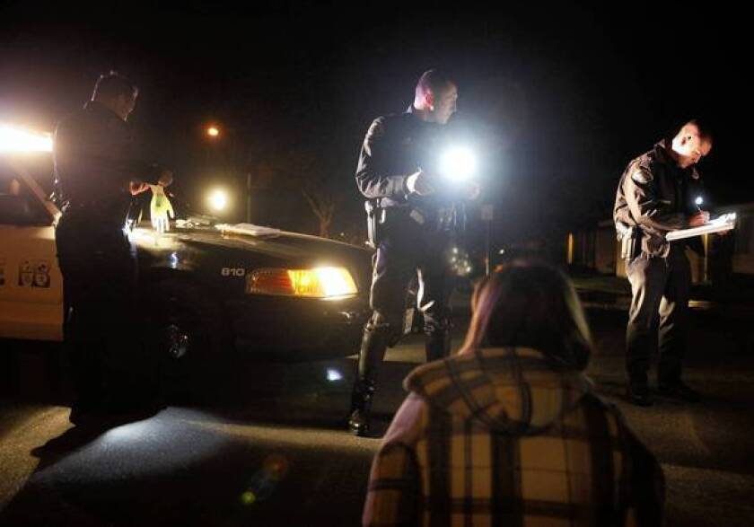 Huntington Beach police officers during a DUI investigation in 2011.The Orange County Crime Lab has found inaccurate test results in more than 2,200 DUI cases.