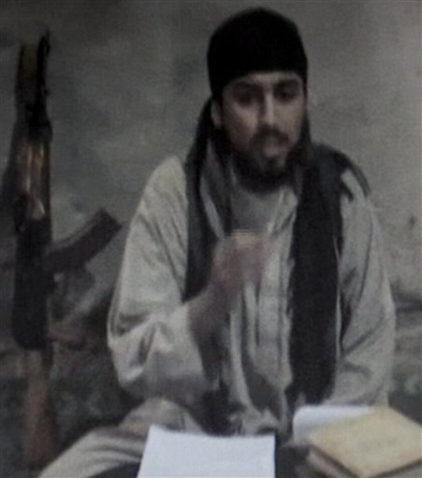 """In this undated image made from a video by the Islamic Movement of Uzbekistan, German speaker Mounir Chouka, who goes locally by the name Abu Adam al-Almani, """"Abu Adam the German"""", speaks from an unknown location. Between 15 and 40 Germans and a smaller contingent of other Europeans are believed to be getting militant training in Pakistan's lawless border region, intending to join the Taliban's fight against NATO forces in neighboring Afghanistan or return to Europe and strike at the soft underbelly of those countries. (AP Photo/Islamic Movement of Uzbekistan)"""