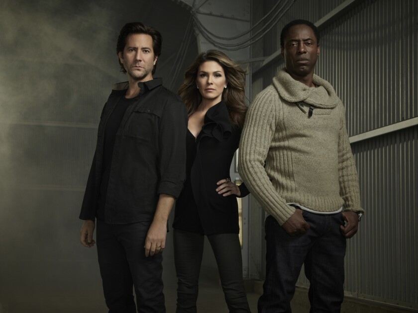 "Henry Ian Cusick, Paige Turco and Isaiah Washington in ""The 100."""