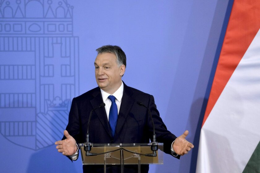Hungarian Prime Minister Viktor Orban addresses diplomats during the annual conference of heads of Hungarian missions abroad in the Ministry of Foreign Affairs and Trade in Budapest, Hungary, Monday, Feb. 29, 2016. Orban said neighboring Romania is waging a 'political campaign' against the leaders of Romania's large Hungarian minority. (Szilard Koszticsak/MTI via AP)