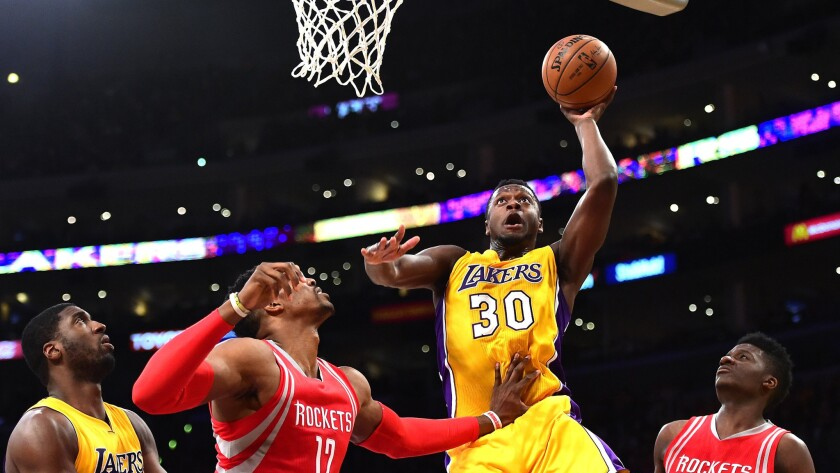 Lakers forward Julius Randle drives for a layup against the Rockets on Thursday night.