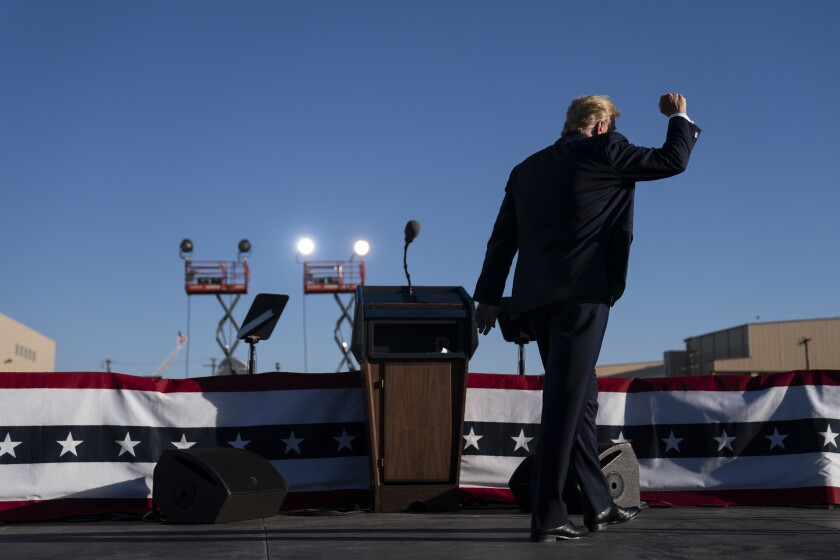 President Trump leaves the stage after speaking during a campaign rally near Phoenix on Wednesday.