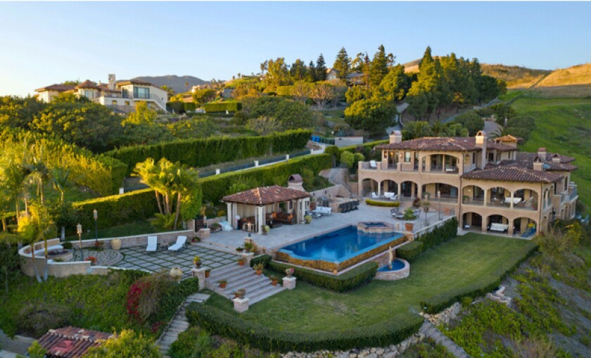 The 3.5-acre estate has a three-story mansion, a detached garage and a scenic patio with a swimming pool, spa and cabana.