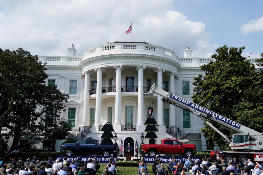 President Trump speaks on the South Lawn of the White House on July 16 with trucks and props in the background.