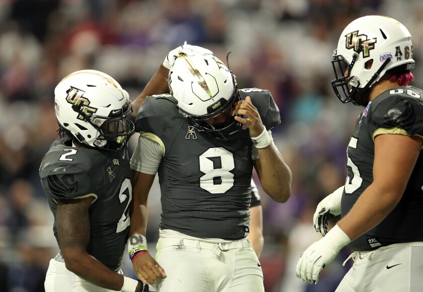 Central Florida running back Otis Anderson hugs quarterback Darriel Mack Jr. at the Fiesta Bowl.