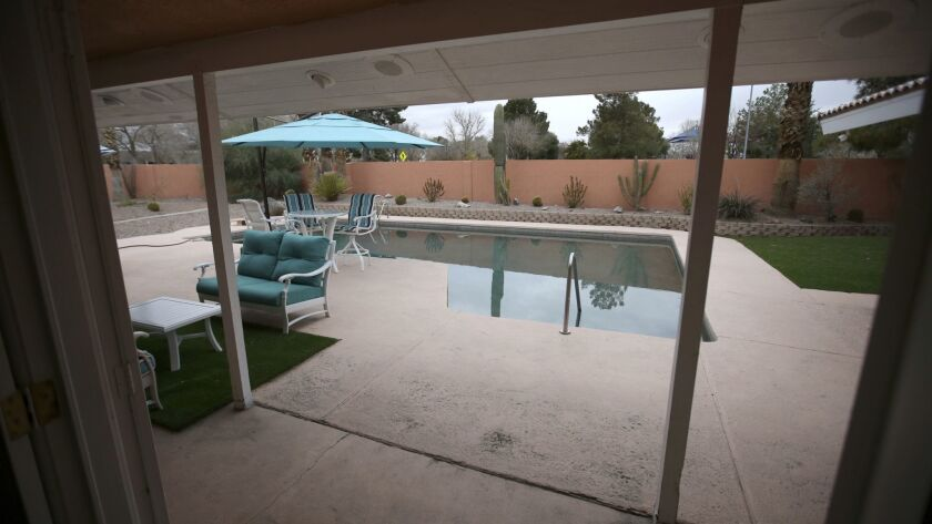 This Jan. 14, 2019 photo shows the backyard swimming pool of the former home of Las Vegas mobster To