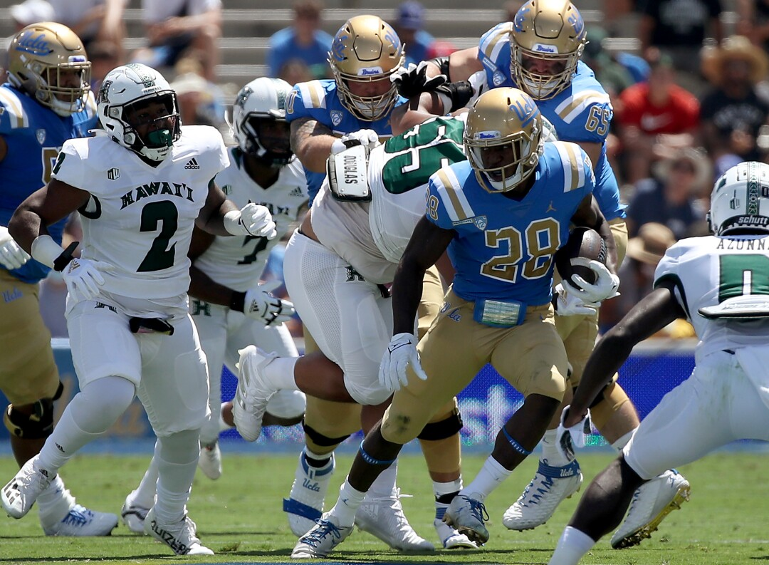 UCLA running back Brittain Brown looks for room to run against Hawaii in the second quarter.