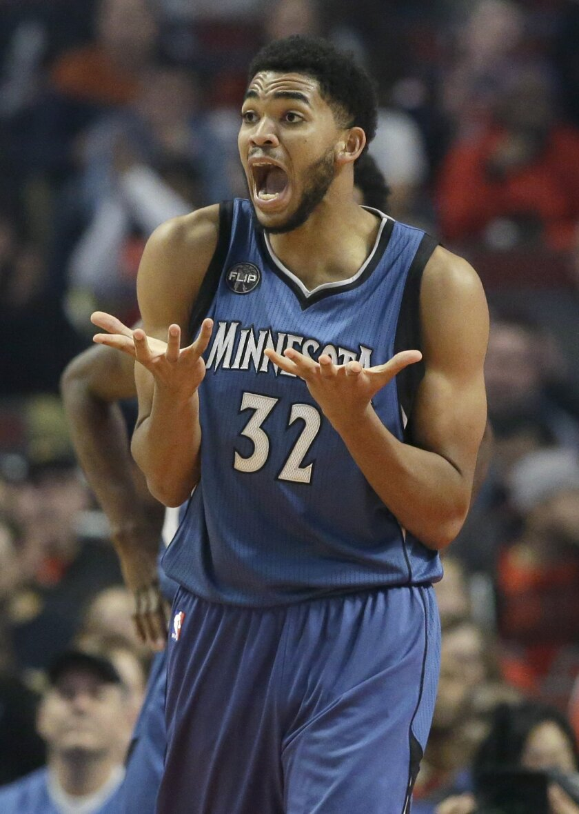 Minnesota Timberwolves center Karl-Anthony Towns reacts to a call during the first half of an NBA basketball game against the Chicago Bulls on Saturday, Nov. 7, 2015,  in Chicago. (AP Photo/Nam Y. Huh)