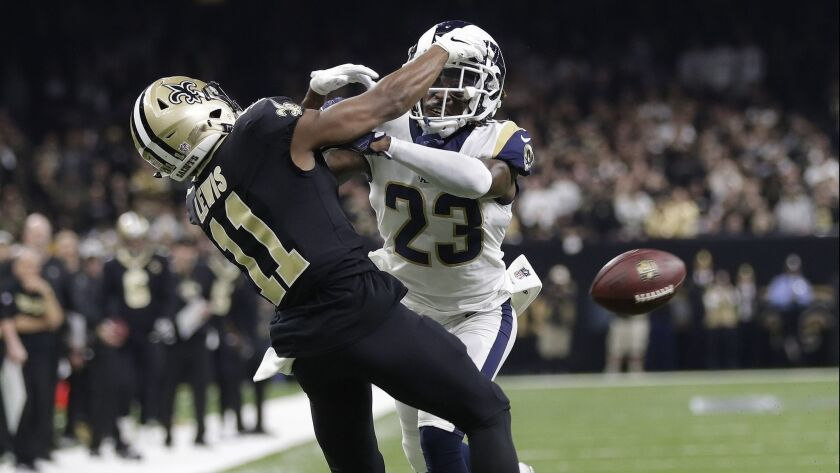 Los Angeles Rams' Nickell Robey-Coleman breaks up a pass intended for New Orleans Saints' Tommylee L