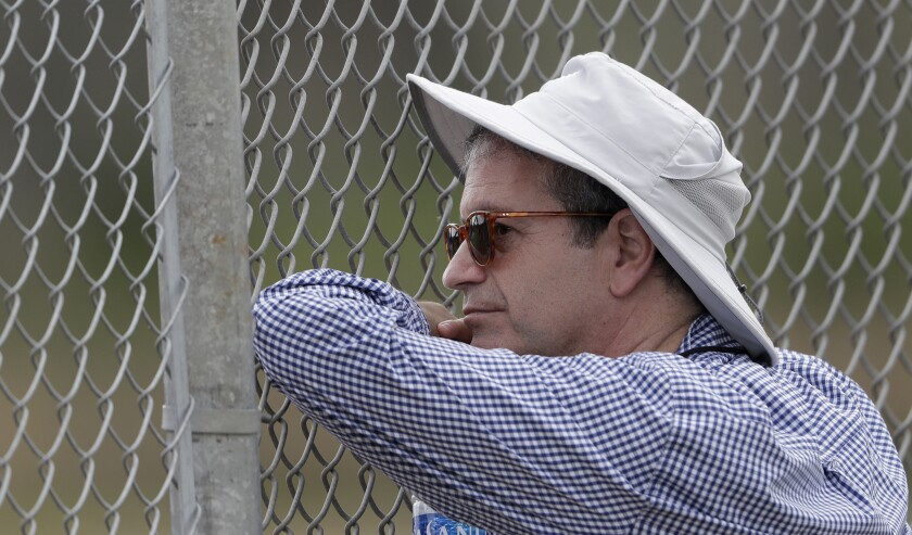Tampa Bay Rays principal owner Stuart Sternberg watches his pitching staff throw.