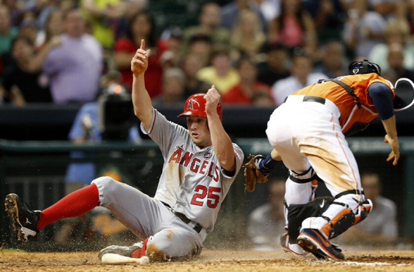 Angels outfielder Peter Bourjos scores in the eighth inning Friday night in Houston, beating the throw to Astros catcher Jason Castro. On Saturday, Bourjos was injured yet again.