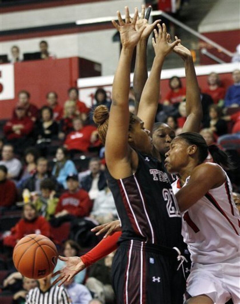 Rutgers' Khadijah Rushdan (1), right, gets off a pass between Temple's Nikki Works, left, and Victoria Macaulay during the first half of an NCAA college basketball game in Piscataway, N.J., Wednesday, Nov. 30, 2011. (AP Photo/Mel Evans)
