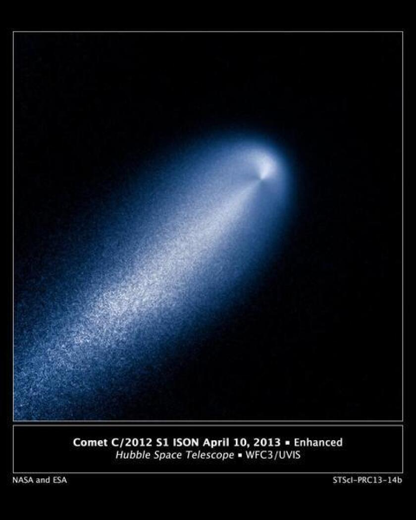 An enhanced image of comet ISON taken with the Hubble Space Telescope. Reports of its imminent demise as it approaches the sun are greatly exaggerated, astronomers say.