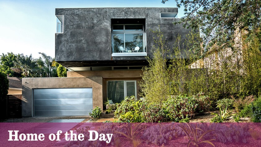 The custom-built contemporary is listed at $6.898 million.
