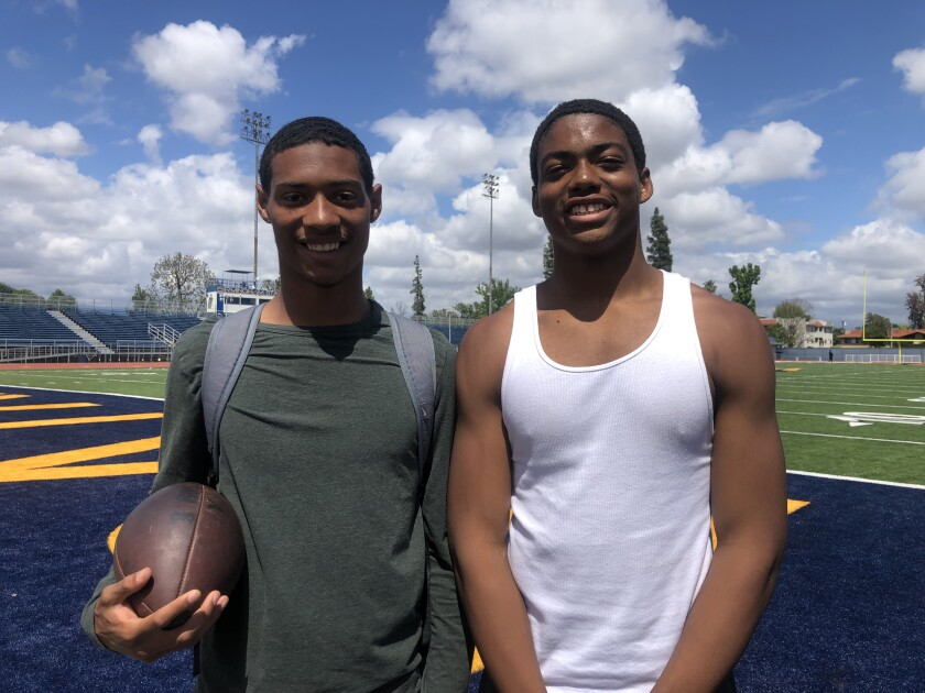 Mason White, left, and Arlis Boardingham are top football players for Birmingham.