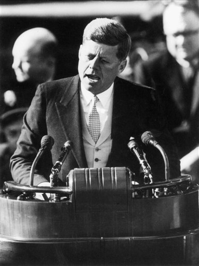 IN this Jan. 20, 1961, file photo, President John F. Kennedy delivers his inaugural address after taking the oath of office at the Capitol in Washington. Some of the inaugurations that loom large in history were seen quite differently at the time. (AP Photo, File)