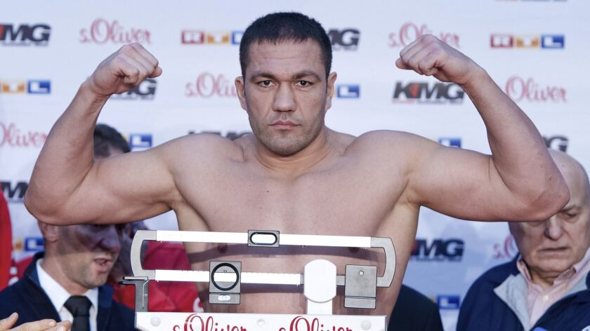 FILE - In this Nov. 14, 2014, photo, Bulgarian boxer Kubrat Pulev weighs in for his fight against Wl