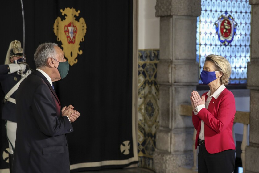 European Commission President Ursula Von Der Leyen visits Portuguese President Marcelo Rebelo de Sousa at the Belem presidential palace in Lisbon, Portugal, Friday, Jan. 15, 2021. Von Der Leyen is in Lisbon to attend a meeting of the the Portuguese presidency of the EU with the College of Commissioners of the European Commission. (Manuel de Almeida/Pool via AP)