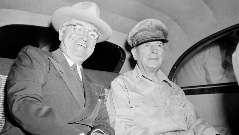 President Harry S. Truman is smiling, but he was not happy about having to fly 14,400 miles for this meeting with Gen. Douglas MacArthur.