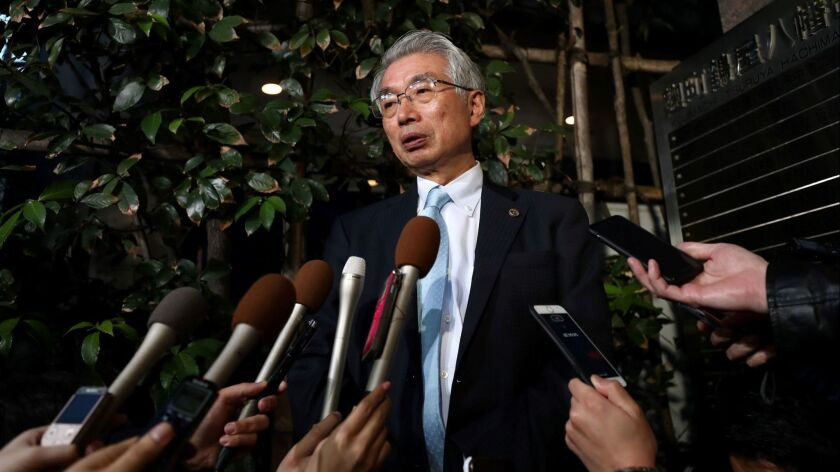 Junichiro Hironaka, lawyer for former Nissan chief Carlos Ghosn, speaks with the media outside his office in Tokyo on March 11. A Japanese court barred Carlos Ghosn from attending a Nissan board meeting.
