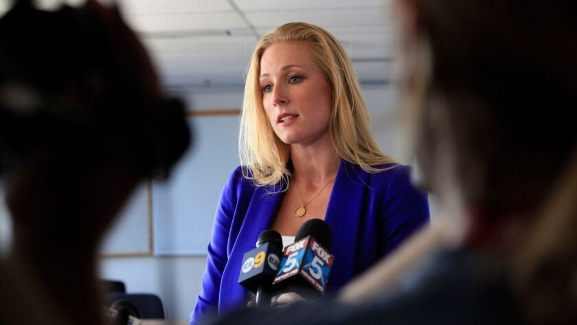 Political consultant Laura Fink who had accused Mayor Filner of making unwanted sexual advances addresses the media outside an open session of the San Diego City Council Friday. April 19, 2013
