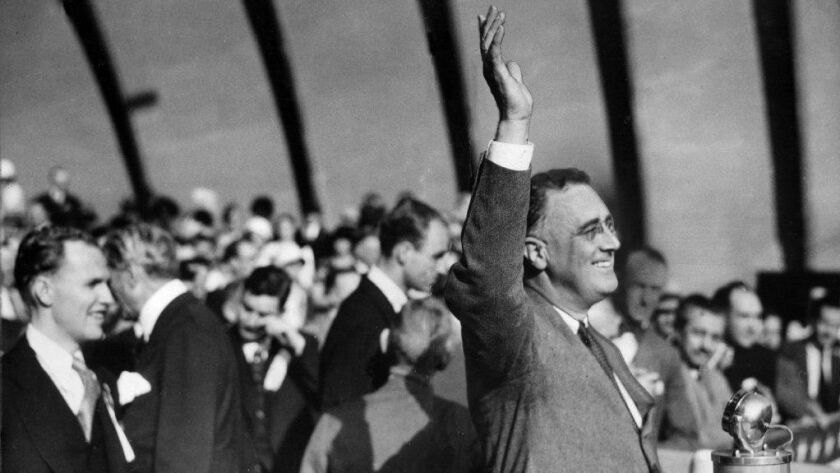 Franklin D. Roosevelt waves to the crowd at the Hollywood Bowl during his campaign for president in 1932.
