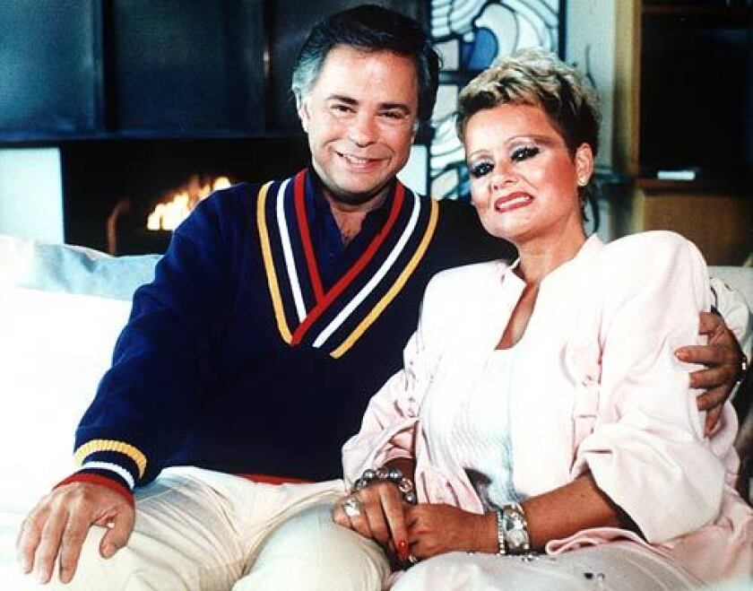Televangelist Jim Bakker, seen in 1987 with his then-wife Tammy Faye Messner, is being sued by the state of Missouri for pitching a product he says can diagnose and cure COVID-19.