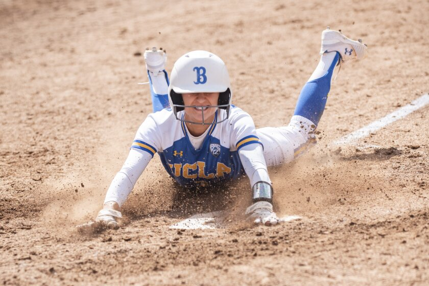 UCLA's Briana Perez slides in to home plate during Game 1 of the L.A. Regional championship against Missouri on May 19. The Bruins are looking to successfully defend their 2019 NCAA title this season.