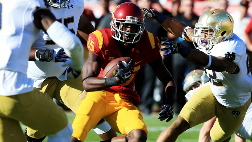 USC wide receiver Nelson Agholor sprints through the Notre Dame defense on his way to scoring a touchdown during the second quarter on Saturday.