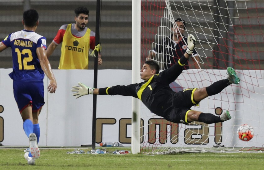 FILE - In this Tuesday, Oct. 13, 2015, file photo, Philippines' goalkeeper Neil Etheridge fails to block a Bahrain goal during a preliminary joint qualifier for the 2018 FIFA World Cup and the 2019 AFC Asian Cup in Riffa, Bahrain. Philippines goalkeeper Neil Etheridge has been hospitalized with COVID-19, it was announced Wednesday, July 14, 2021. (AP Photo/Hasan Jamali, file)