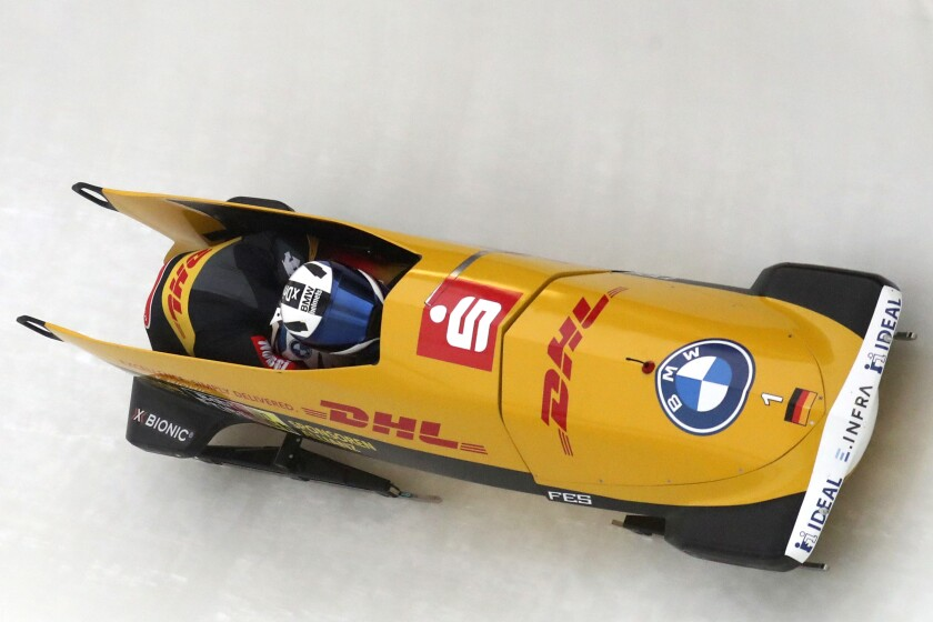 Francesco Friedrich and Alexander Schueller of Germany speed down the track during the two men's bobsleigh race at the Bobsleigh and Skeleton World Championships in Altenberg, Germany, Sunday, Feb. 7, 2021. (AP Photo/Matthias Schrader)