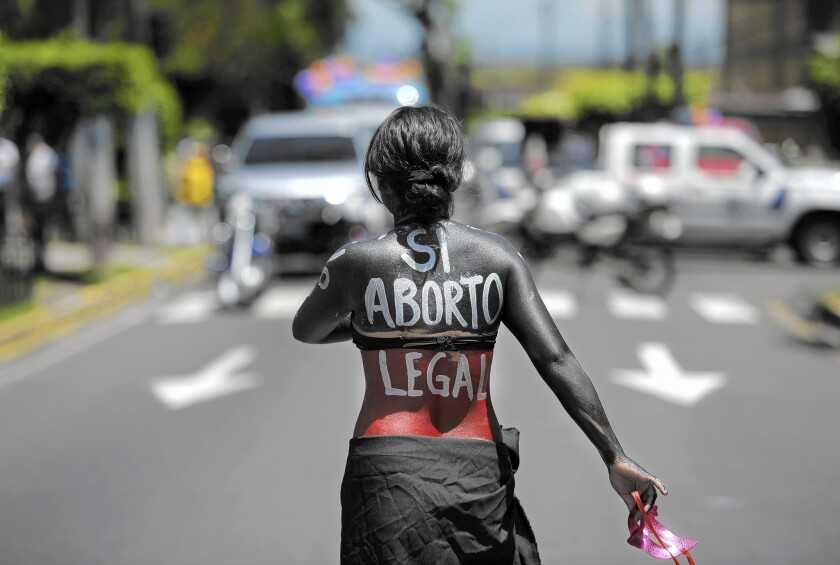 A woman participates in a march on the International Day of Action for the Decriminalization of Abortion on Sept. 28, 2012, in San Salvador.