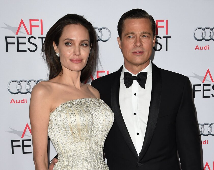 """Angelina Jolie and Brad Pitt arrive for the opening-night premiere of """"By the Sea"""" during AFI Fest 2015 at the TCL Chinese Theatre in Hollywood."""