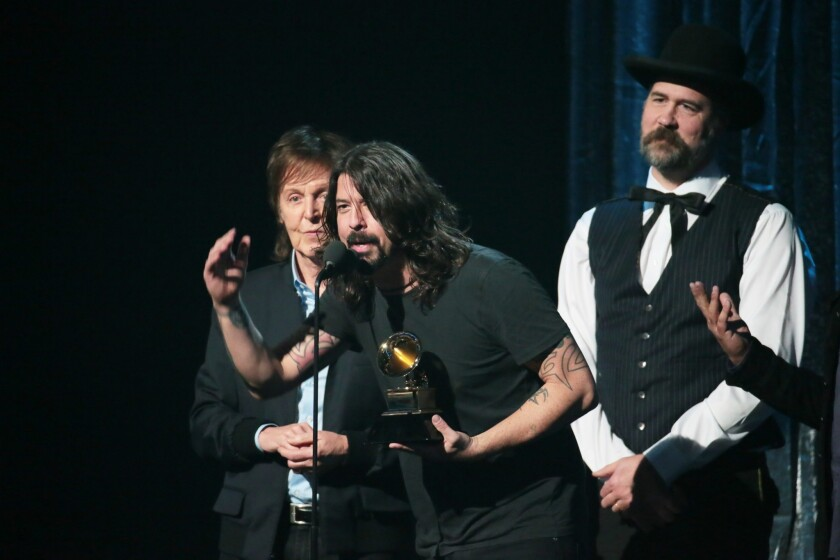 "Paul McCartney, Dave Grohl and Krist Novoselic accept the Grammy for best rock song for ""Cut Me Some Slack."""
