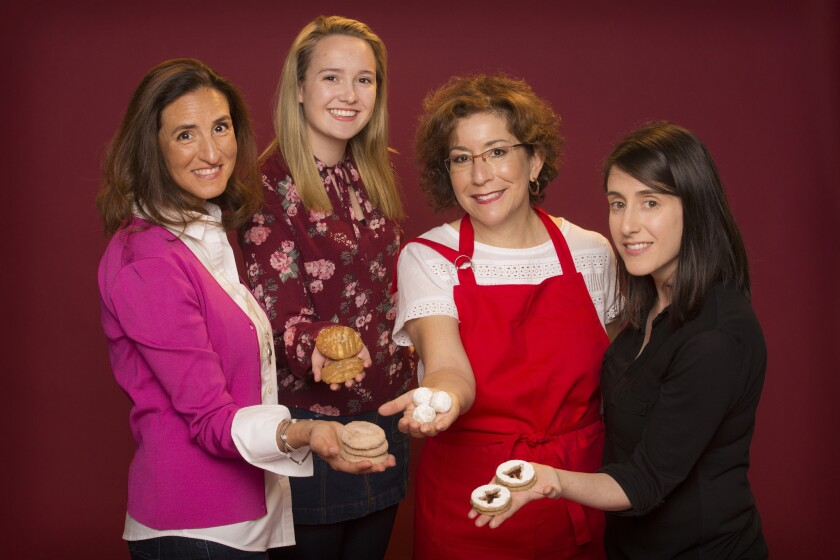 Four of the top five contestants from the 6th Los Angeles Times Holiday Cookie Bake-Off. Lt to Rt: Deborah Pappalau, Fiona Marshall, Beth Corman Lee and Jessica Levy holding their cookies.