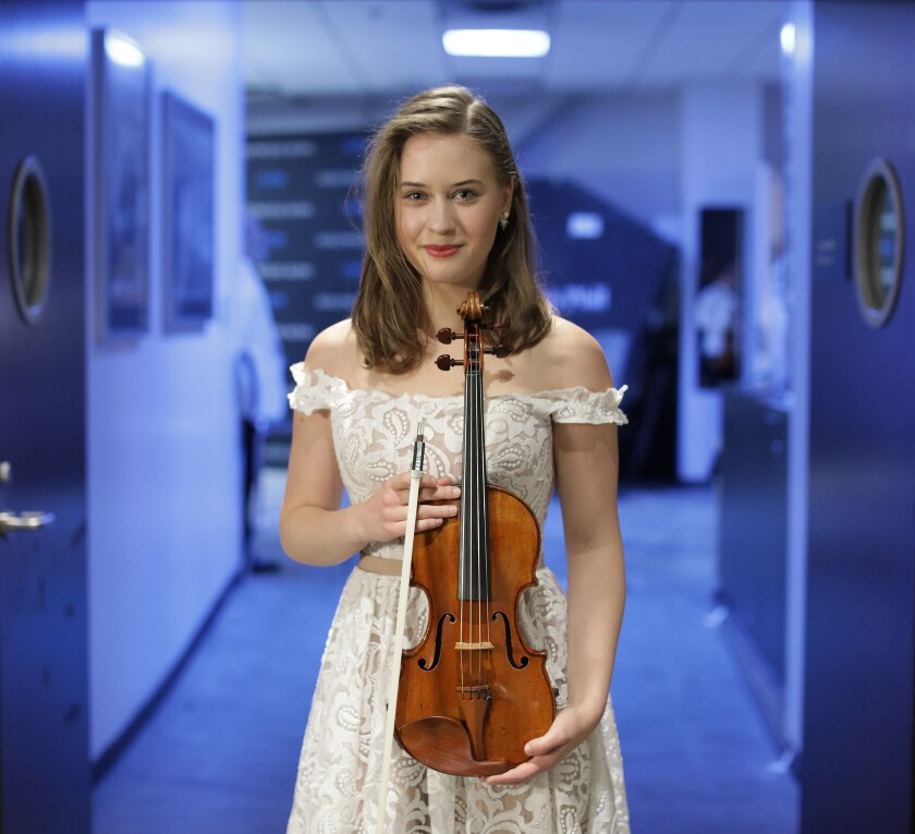 18-year-old Play With Ray contest winner Laura Kukkonen of Helsinki poses with her violin.