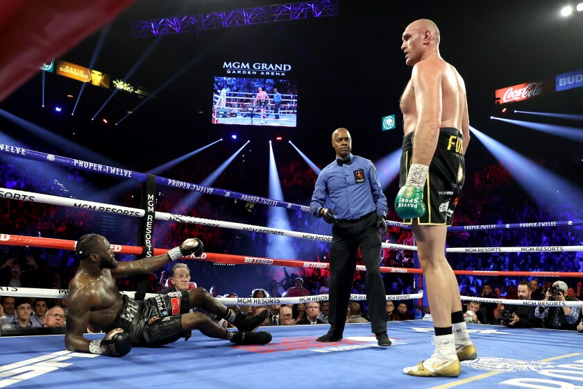 Deontay Wilder is sent to the canvas by Tyson Fury during the third round of their WBC heavyweight title fight on Feb. 22, 2020, in Las Vegas.