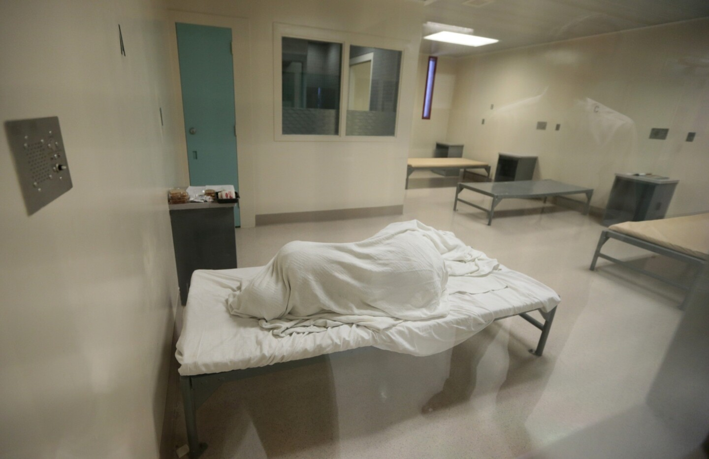 An inmate sleeps in a room on the fourth floor of the medical unit of the Twin Towers jail facility. This area houses inmates with the highest level of need -- both psychiatric and medical.