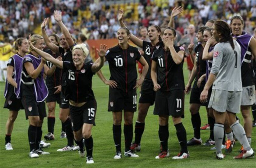 US team celebrate after winning the quarterfinal match between Brazil and the United States at the Women's Soccer World Cup in Dresden, Germany, Sunday, July 10, 2011. (AP Photo/Marcio Jose Sanchez)