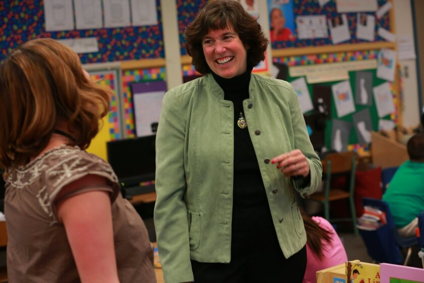 Cindy Robinson, left, first grade teacher, recounts some of the early days of her tenure at Central, since she and now superintendent-elect Cindy Marten, right, started working there the same day as teachers. In a quick unanimous decision Wednesday the San Diego Board of Education announced the replacement for retiring SDUSD superintendent Bill Kowba would be Central Elementary School principal Cindy Marten. On Thursday she returned to the school to hugs, tears, congratulations, accolades and a constant stream of emails and cell texts and calls congratulating her.