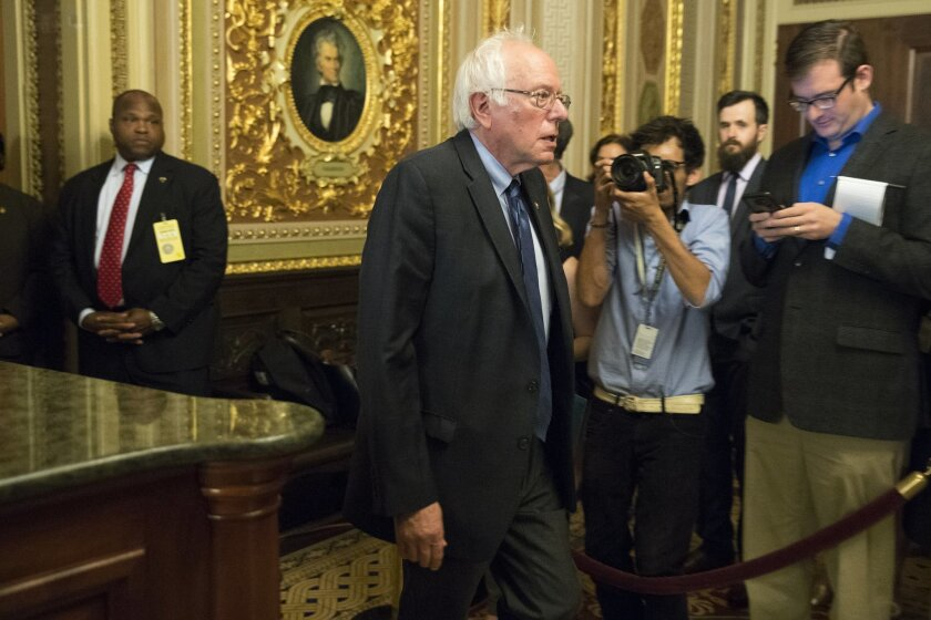 Sen. Bernie Sanders, I-Vt. leaves a meeting hosted by Senate Democrats with Democratic presidential candidate Hillary Clinton on Capitol Hill in Washington, Thursday, July 14, 2016. (AP Photo/Evan Vucci)