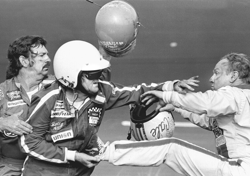 PDN B&W C1 SP 0213 FIGHT -- 47P3X33P4 -- Bobby Allison holds race driver Cale Yarborough's foot af
