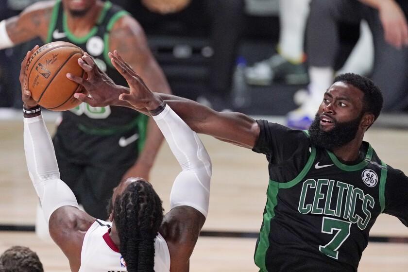 Boston guard Jaylen Brown blocks Miami forward Jae Crowder.